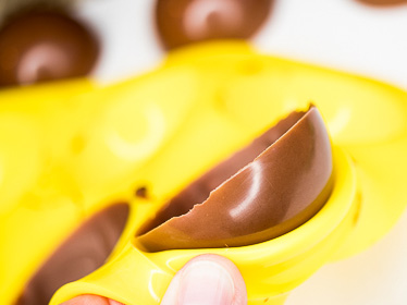 Remove chocolate spheres from mold